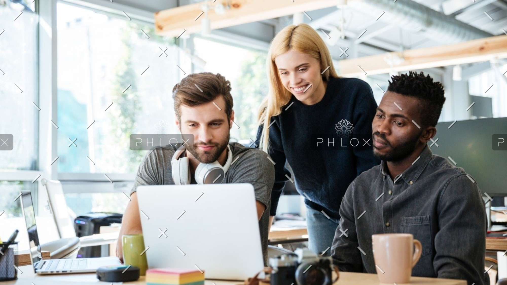 demo-attachment-2719-happy-colleagues-sitting-in-office-coworking-PHYA6TG