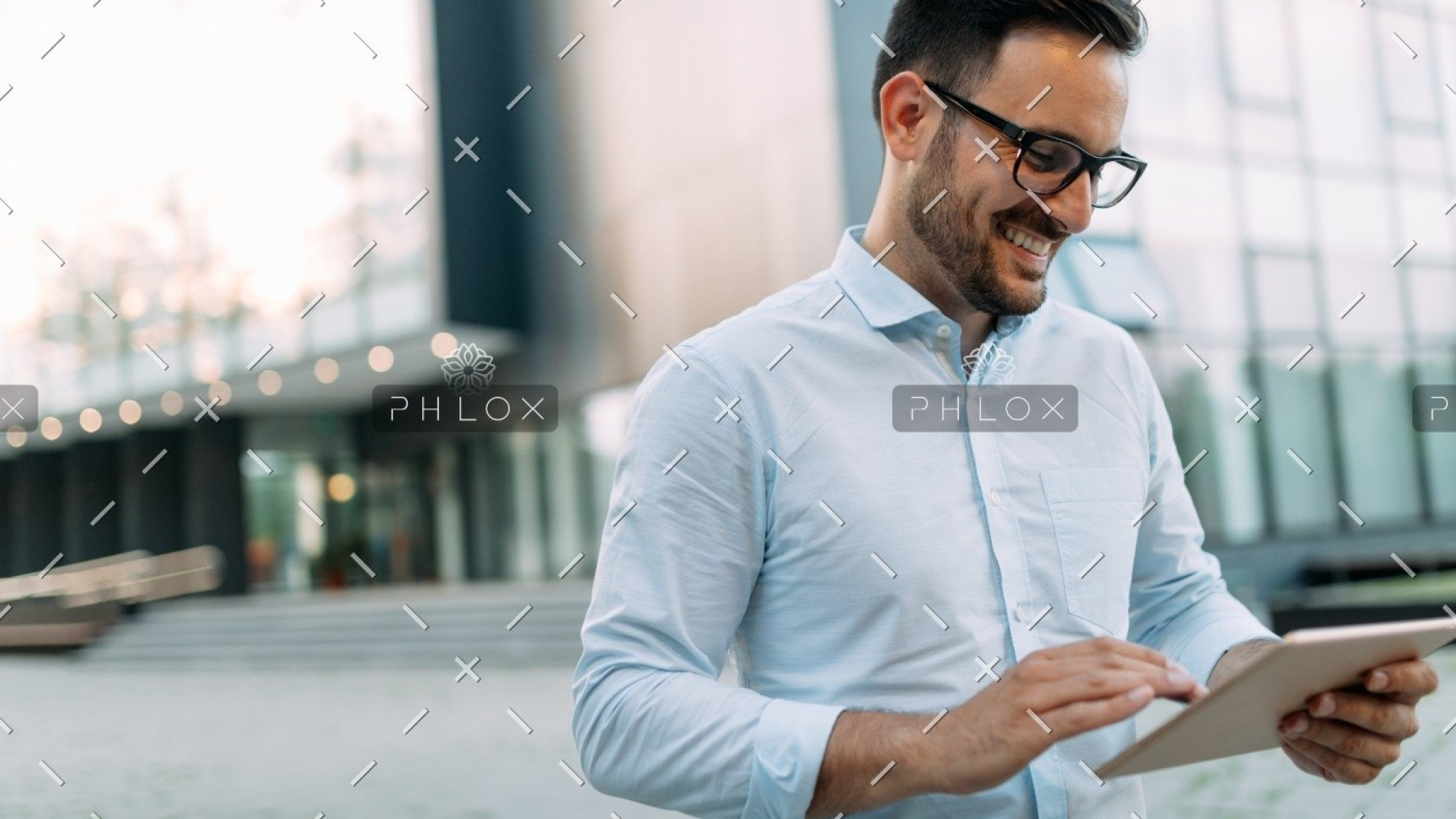 demo-attachment-2721-portrait-of-businessman-in-glasses-holding-tablet-AWVHCJU