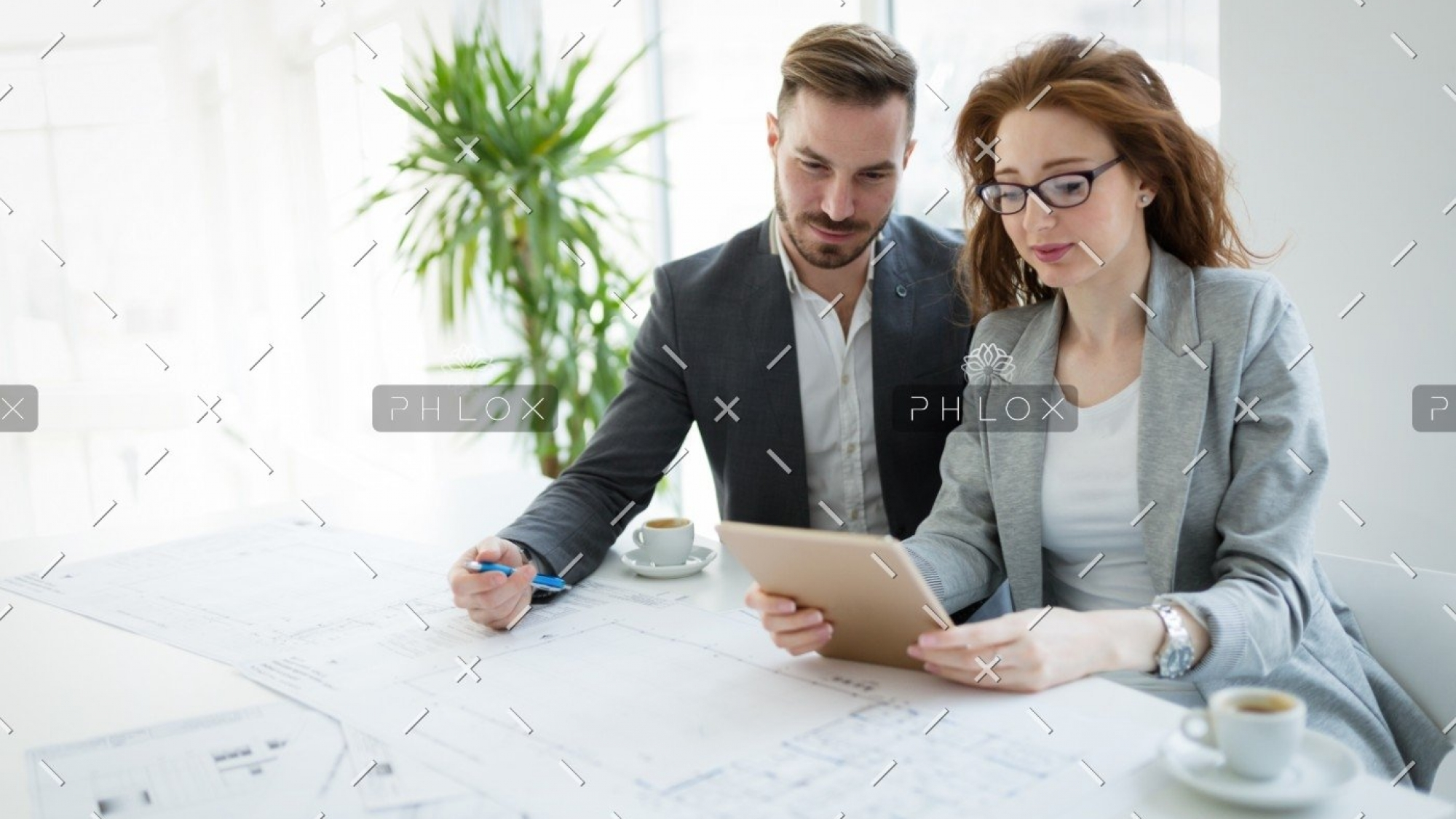 demo-attachment-2723-portrait-of-young-architect-woman-on-meeting-KFZCE3A
